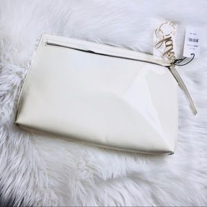 Saks Ivory Clutch patent Bag with Gold Charm .
